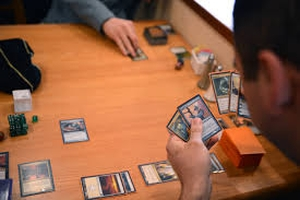 Take a look at Magic The Gathering Deck Builder 34